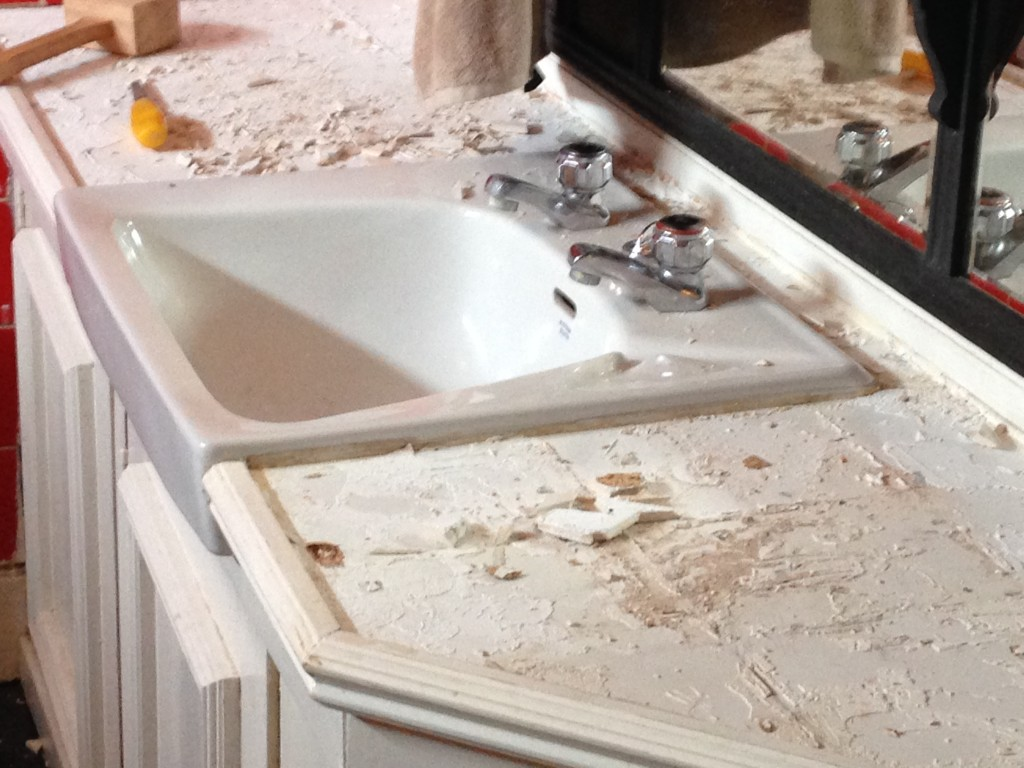 Removing the white tiles on top of the cupboard unit, making room for my lovely mosaics