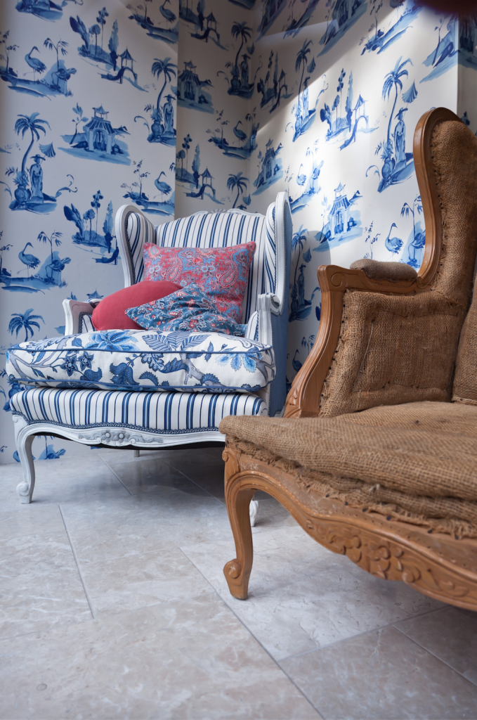 Blue chair covered in 3 different fabrics: floral from Manuel Canovas, stripe from Ralph Lauren, plain on sides from Larsen
