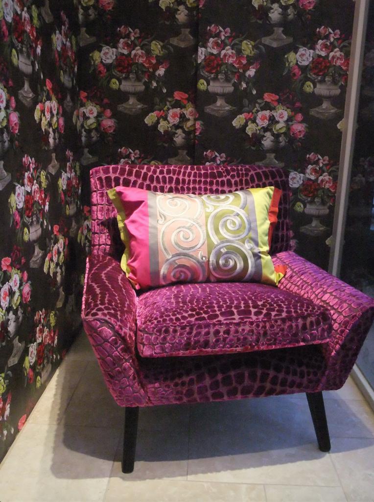 Retro 1960s chair covered in purple patterned velvet