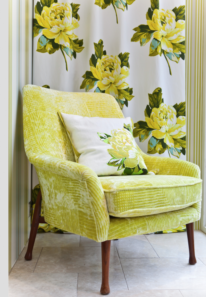Retro 1950s armchair covered in a patterned yellow velvet from Designers Guild