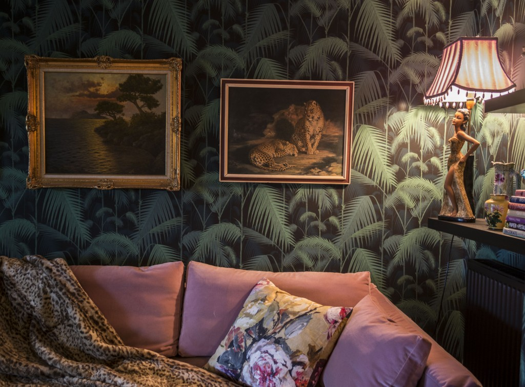 Leopard corner: original 1960's leopard print on the walls, fluffy leopard throw on the sofa