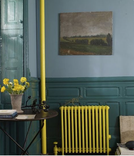 Yellow painted pipes and radiator