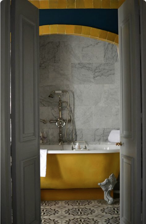 Yellow ochre painted bath