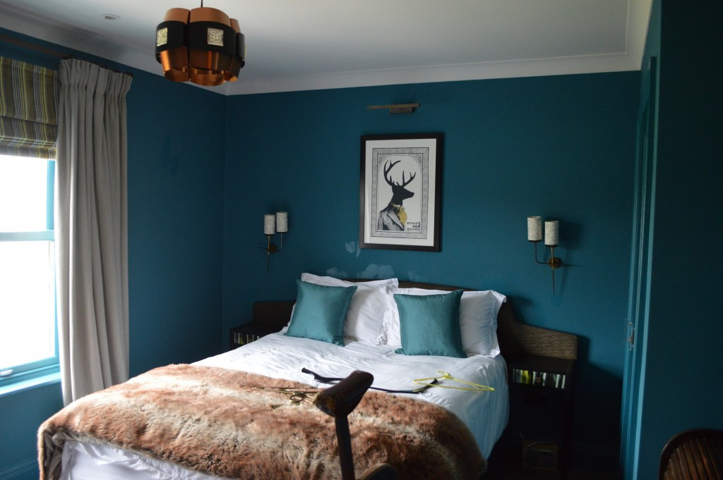 Blue painted walls in a bedroom