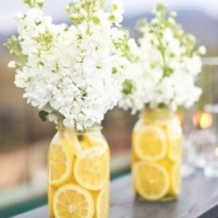 Flowers displayed in a lemon lined Mason jar