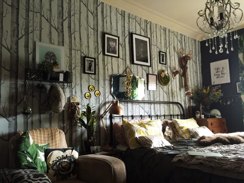 eclectic bedroom with cole and son wallpaper