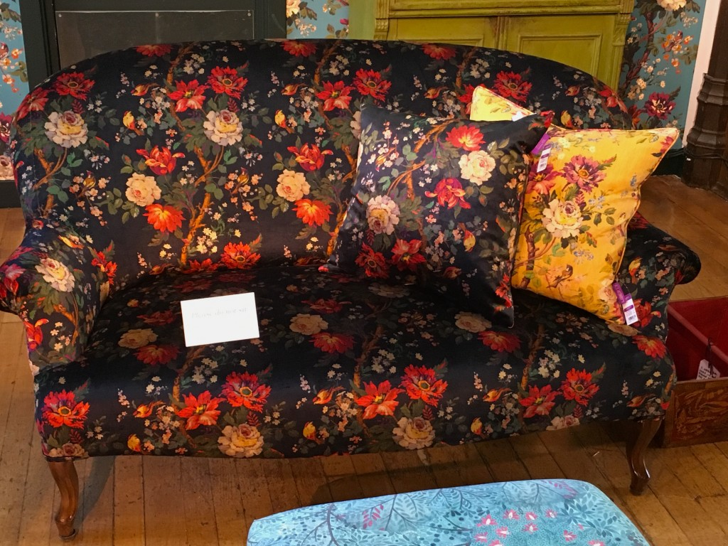 A sofa covered in Lady Kristina Film Noir at Liberty