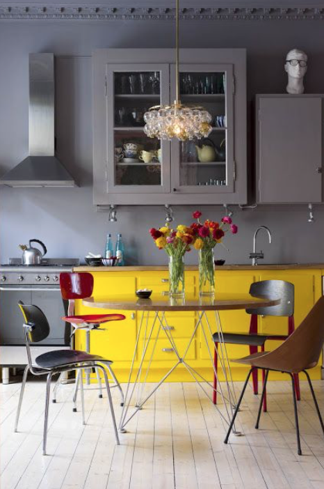Yellow painted kitchen cabinet