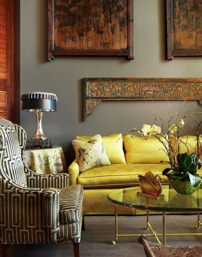 Yellow sofa against grey walls