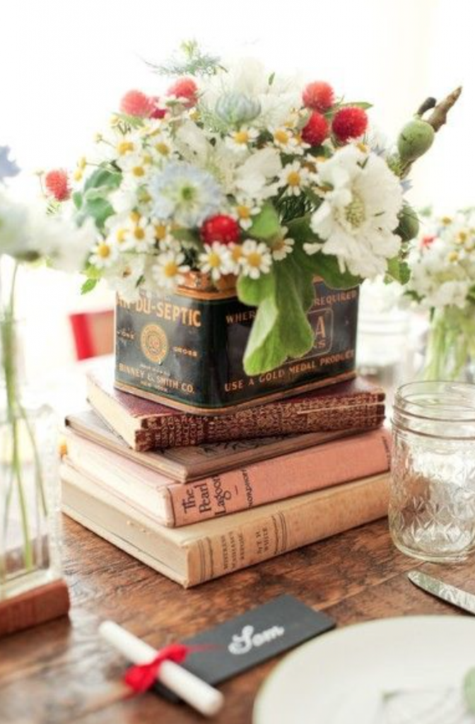 Flower display in a vintage tin box