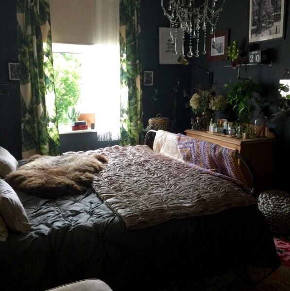dark eclectic bedroom with tropical curtains